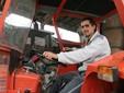 Marco su un trattore dell'azienda
