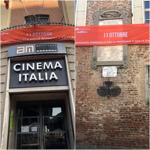 Striscioni arancioni della Campagna INDIFESA sui palazzo comunali di SAluzzo ( palazzo Italia) e Scarnafigi