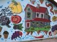 Il murale disegnato da alcuni ragazzi per festeggiare i venti anni dell'azienda