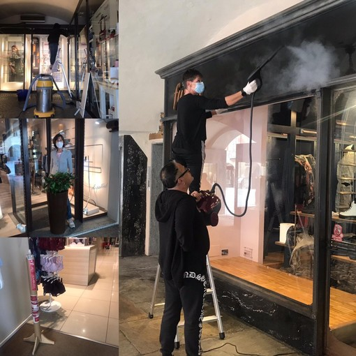 Igienizzazione, pulizia e allestimento delle vetrine: negozi di Cuneo pronti a riaprire