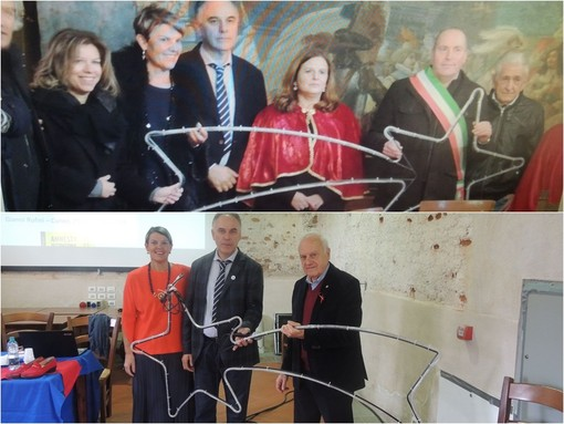 """Nella foto in alto: la consegna della stella """"brillante"""" al sindaco di Dronero Livio Acchiardi."""